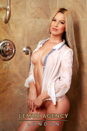 Reneta posing in shower