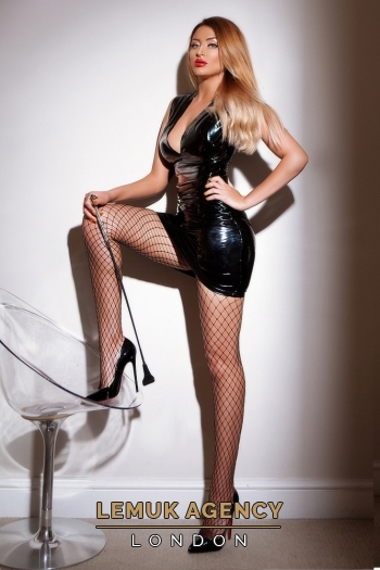 Maya in black PVC and fishnet stockings
