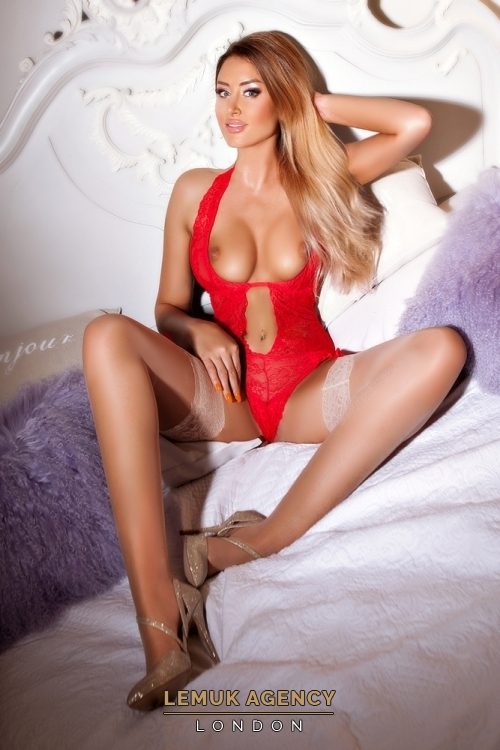 Central London escort Maya in red lingerie and white stockings