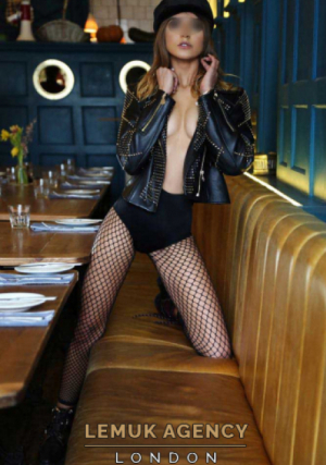 Leona posing in sexy outfit in some restaurant or cafe in London
